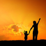 mother-son-playing-outdoors-sunset-silhouette-64792708